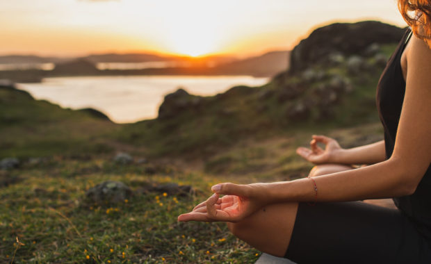 woman in morning meditation at sunrise