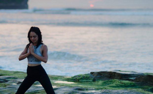 woman doing yoga following ayurveda times of day