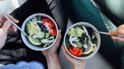 two bowls of vegetables and food