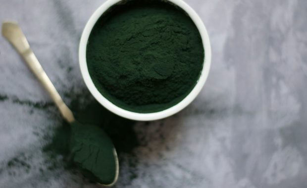 Green powder in bowl and spoon