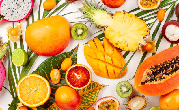 different kinds of fruit on white background