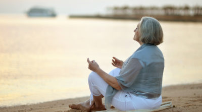 older woman meditating ayurveda for longevity