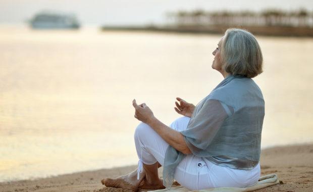 older woman meditating ayurveda for longevity
