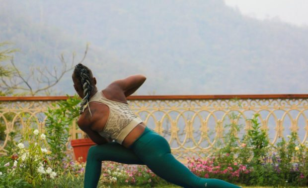 woman twisting in yoga for detox pose