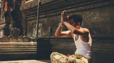 man in lotus pose practicing gratitude yoga