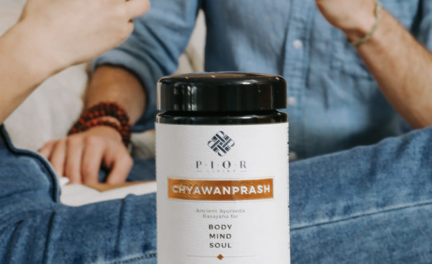 chyawanprash jar in front of people