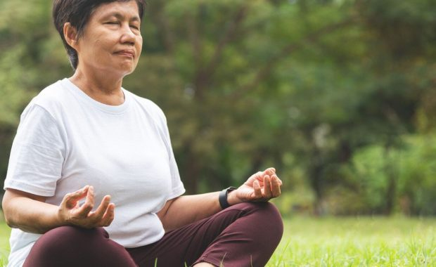 asian senior meditating