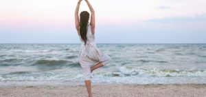 woman on beaching doing yoga for anxiety