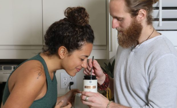 woman and man smelling and tasting chyawanprash
