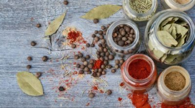 ayurvedic spices in jars on wooden table