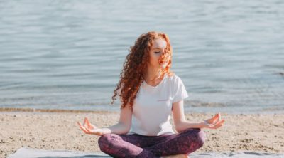 woman with red hair meditating