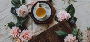 cup of tea on saucer with roses