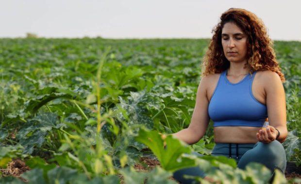 woman with kapha dosha meditating in field